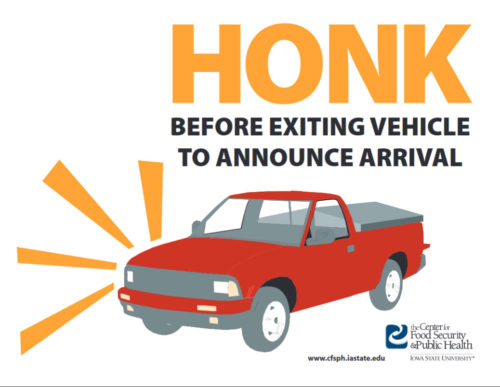 Biosecurity sign stating to honk before exiting vehicle.